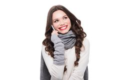 Young smiling woman in scarf and arm warmers talking on smartphone,. Isolated on white stock photography