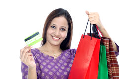 Young smiling woman with shopping bags and credit Royalty Free Stock Images