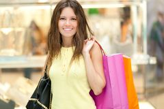 Young smiling woman shopping in the city Royalty Free Stock Image