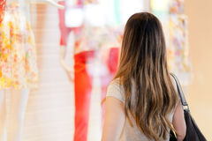 Young smiling woman shopping in the city Royalty Free Stock Photos