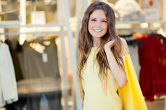 Young smiling woman shopping in the city Stock Photo