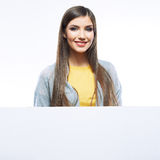 Young smiling woman show blank board. Royalty Free Stock Image