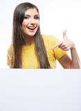 Young smiling woman show blank card. Royalty Free Stock Image
