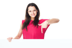 Young smiling woman showing blank signboard Royalty Free Stock Photo