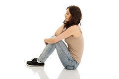 Young smiling woman sitting on the floor. Stock Photo