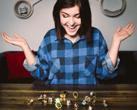 Young smiling woman sitting in front of rings on a table Stock Image