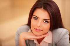 Young smiling woman sitting at the table Royalty Free Stock Images