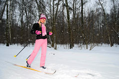 Young smiling woman on ski in park stock image