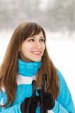 Young smiling woman skiing at the winter outdoor Stock Images