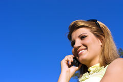Young smiling woman speaks by mobile phone. Stock Image