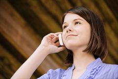 Young smiling woman speaks on phone Royalty Free Stock Photography