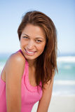 Young smiling woman standing Stock Photography