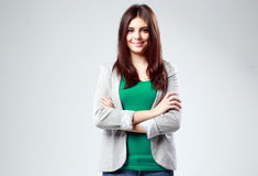 Young smiling woman standing with arms folded Royalty Free Stock Photos