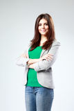 Young smiling woman standing with arms folded Royalty Free Stock Image