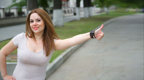 A young smiling woman on the street Stock Image