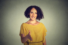 Young smiling woman, student, customer service agent giving you handshake Royalty Free Stock Photography