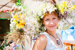 Young smiling woman with summer flowers wreath on head Stock Images