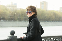 Young smiling woman in sunglasses Stock Photo