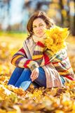 Young beautiful woman in sunny park. Young smiling woman in sunny autumn park Royalty Free Stock Images
