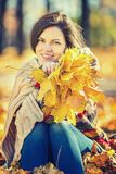 Young beautiful woman in sunny park. Young smiling woman in sunny autumn park Royalty Free Stock Photos
