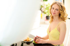 young smiling woman at table with breakfast Stock Photography