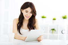 Young smiling  woman  with tablet pc Stock Image