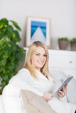 Young Smiling Woman With Tablet Royalty Free Stock Photos