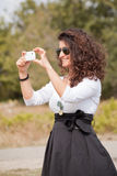 Young smiling woman taking picture Stock Photo