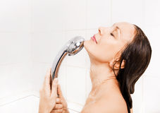 Young smiling woman taking a shower Royalty Free Stock Photography