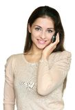 Young smiling woman talking mobile Stock Photos