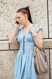 Young smiling woman talking on mobile phone smartphone Royalty Free Stock Photography