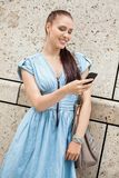 Young smiling woman talking on mobile phone smartphone Stock Photo