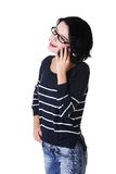 Young smiling woman talking on the phone Stock Photography