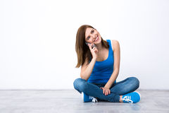 Young smiling woman talking on the phone Royalty Free Stock Photography
