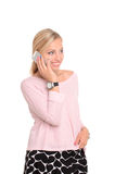 Young smiling woman talking on phone Stock Images