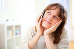 Young smiling woman talking on telephone Stock Photos