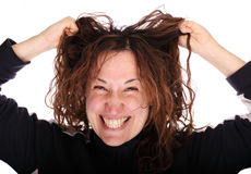 Young smiling woman tearing her hair Stock Image