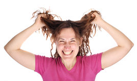 Young smiling woman tearing her hair Royalty Free Stock Image