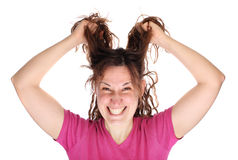 Young smiling woman tearing her hair Royalty Free Stock Photos
