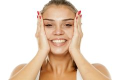 Woman tightening her face. Young smiling woman tightening her face with her hands Stock Photo