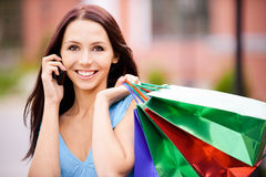 Young smiling woman to purchases Stock Image