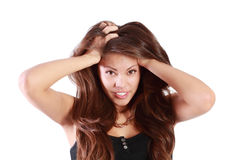 Young smiling woman touches her hair Royalty Free Stock Photo