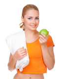 Young smiling woman with towel and apple Royalty Free Stock Photo