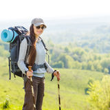 Young smiling woman traveling with backpack Stock Photo