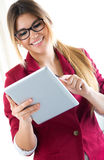 Young smiling woman using digital tablet. Isolated on white. Royalty Free Stock Photo