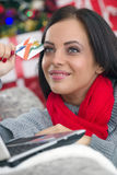 Young smiling woman using laptop and credit card