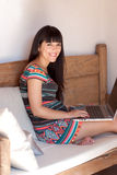 Young smiling woman using a laptop Royalty Free Stock Photo