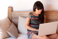 Young smiling woman using a laptop Royalty Free Stock Image