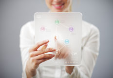 Young smiling woman using tablet computer Royalty Free Stock Images