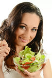 Young smiling woman with vegetable salad bowl Royalty Free Stock Image